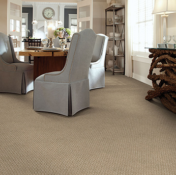 Dining room scene with tan American Showcase carpet.
